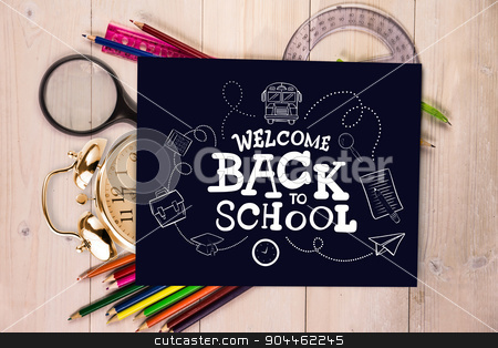 Composite image of back to school stock photo, back to school against students desk with black page by Wavebreak Media