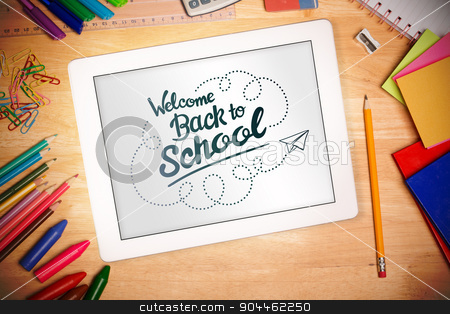 Composite image of back to school stock photo, back to school against students desk with tablet pc by Wavebreak Media