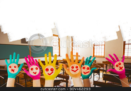 Composite image of hands with colourful smiley faces stock photo, Hands with colourful smiley faces against empty classroom by Wavebreak Media