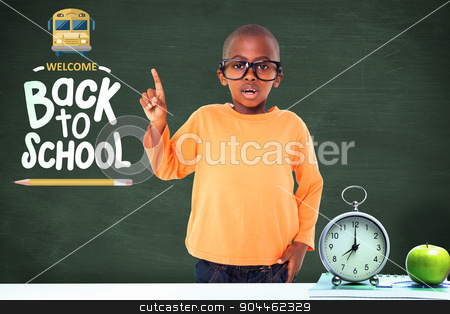 Composite image of cute boy smiling and pointing stock photo, Cute boy smiling and pointing against green chalkboard by Wavebreak Media