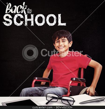 Composite image of portrait of boy sitting in wheelchair stock photo, Portrait of boy sitting in wheelchair against black by Wavebreak Media