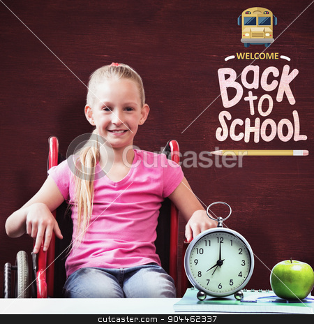 Composite image of cute disabled pupil smiling at camera in hall stock photo, Cute disabled pupil smiling at camera in hall  against desk by Wavebreak Media
