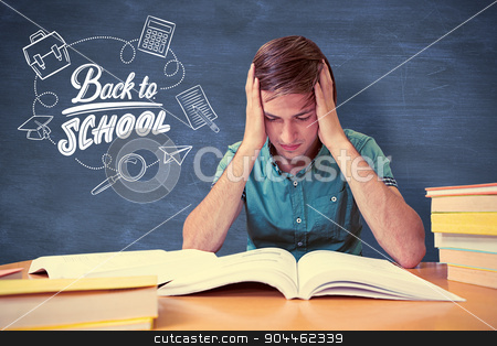 Composite image of student sitting in library reading  stock photo, Student sitting in library reading  against blue chalkboard by Wavebreak Media