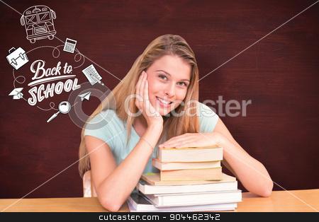 Composite image of portrait of female student in library stock photo, Portrait of female student in library against desk by Wavebreak Media