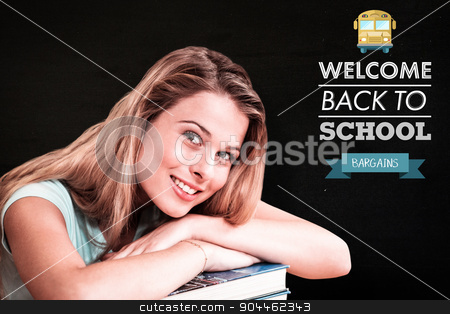 Composite image of portrait of female student in library stock photo, Portrait of female student in library against black by Wavebreak Media