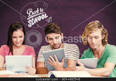 Composite image of college students using digital tablets in lib stock photo, College students using digital tablets in library against green chalkboard by Wavebreak Media