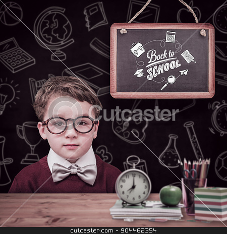 Composite image of cute schoolboy wearing reading glasses stock photo, Cute schoolboy wearing reading glasses against bleached wooden planks background by Wavebreak Media