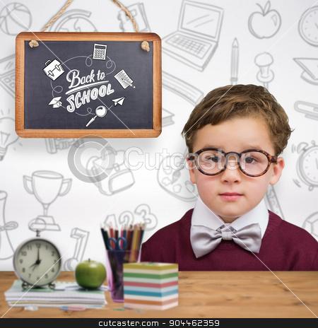 Composite image of cute schoolboy wearing reading glasses stock photo, Cute schoolboy wearing reading glasses against bleached wooden planks background by Wavebreak Media