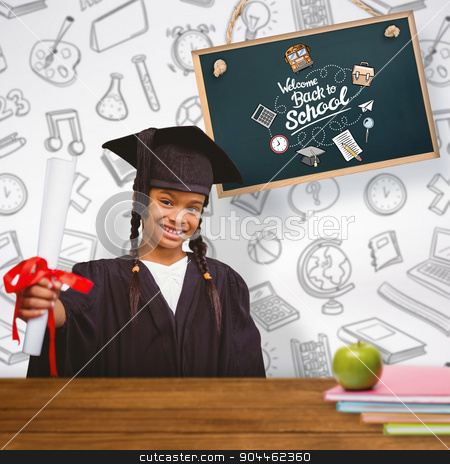 Composite image of cute pupil in graduation robe stock photo, Cute pupil in graduation robe against overhead of wooden planks by Wavebreak Media