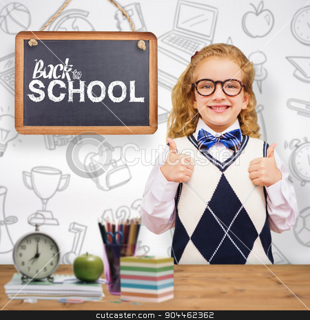 Composite image of cute pupil with thumbs up stock photo, Cute pupil with thumbs up against bleached wooden planks background by Wavebreak Media
