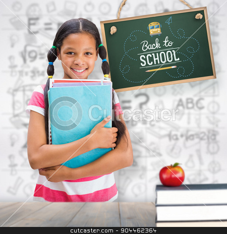 Composite image of cute pupil smiling at camera in library  stock photo, Cute pupil smiling at camera in library  against pale grey wooden planks by Wavebreak Media