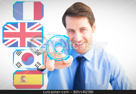 Composite image of friendly businessman pointing at the camera stock photo, Friendly businessman pointing at the camera against blue interface by Wavebreak Media
