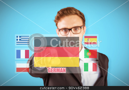 Composite image of young serious businessman pointing at camera stock photo, Young serious businessman pointing at camera against blue background with vignette by Wavebreak Media