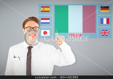 Composite image of geeky businessman smiling and pointing stock photo, Geeky businessman smiling and pointing against grey background by Wavebreak Media