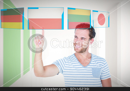 Composite image of handsome man pointing at something stock photo, Handsome man pointing at something against modern white and green room with window by Wavebreak Media