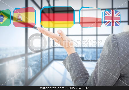 Composite image of businesswoman doing speech  stock photo, Businesswoman doing speech  against room with large windows showing city by Wavebreak Media