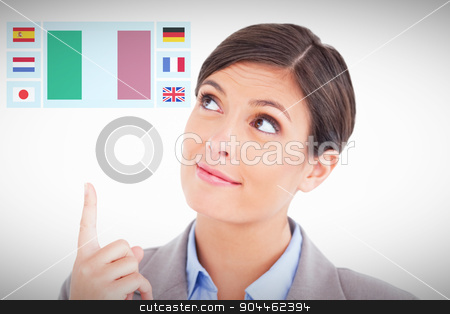 Composite image of close up of female entrepreneur pointing and  stock photo, Close up of female entrepreneur pointing and looking up against white background with vignette by Wavebreak Media