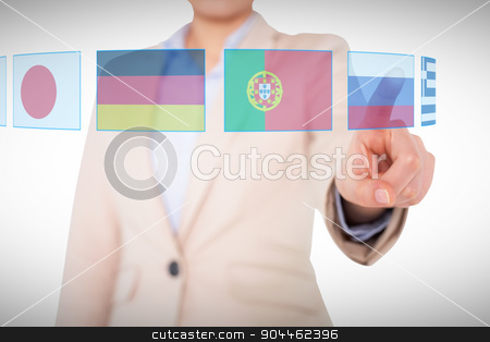 Composite image of businesswoman pointing stock photo, Businesswoman pointing against white background with vignette by Wavebreak Media