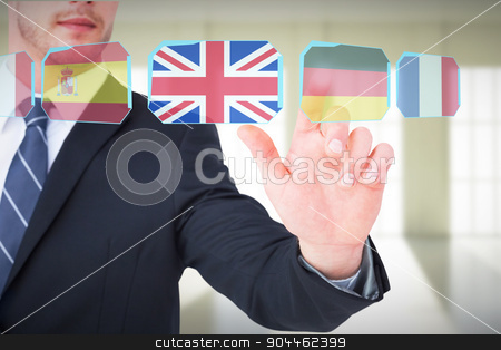 Composite image of focused businessman pointing with his finger stock photo, Focused businessman pointing with his finger against room with windows by Wavebreak Media