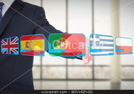 Composite image of businessman in suit pointing his finger stock photo, Businessman in suit pointing his finger against window overlooking city by Wavebreak Media