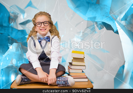 Composite image of cute pupil sitting on table  stock photo, Cute pupil sitting on table  against angular design by Wavebreak Media