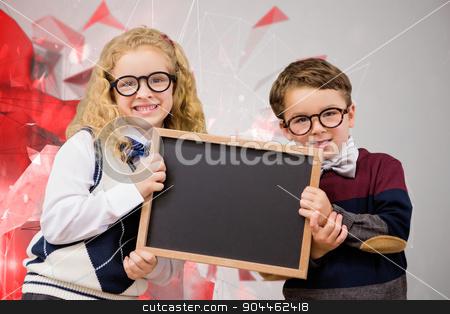 Composite image of pupils showing chalkboard stock photo, Pupils showing chalkboard against angular design by Wavebreak Media