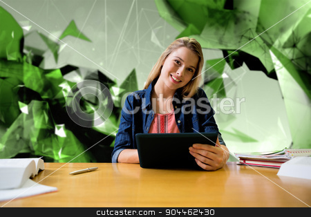 Composite image of student studying in the library with tablet stock photo, Student studying in the library with tablet against angular design by Wavebreak Media