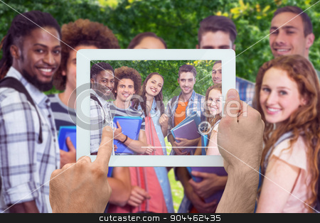 Composite image of hand holding tablet pc stock photo, Hand holding tablet pc against park by Wavebreak Media
