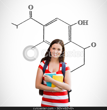 Composite image of student smiling at camera in library stock photo, Student smiling at camera in library against science formula by Wavebreak Media
