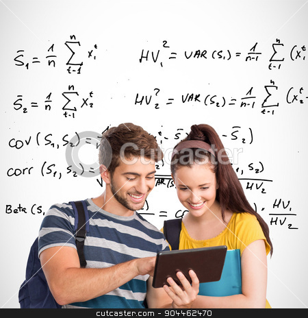 Composite image of happy students using tablet pc stock photo, Happy students using tablet pc against maths equations by Wavebreak Media