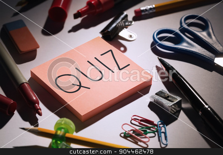 Quiz against students table with school supplies stock photo, The word quiz against students table with school supplies by Wavebreak Media