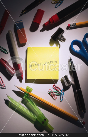 Online education against students table with school supplies stock photo, The word online education against students table with school supplies by Wavebreak Media