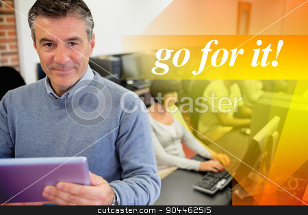 Go for it! against teacher holding a tablet pc stock photo, The word go for it! against teacher holding a tablet pc by Wavebreak Media