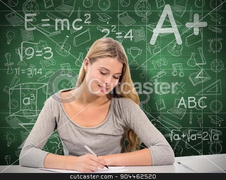 Composite image of student working stock photo, Student working against green chalkboard by Wavebreak Media