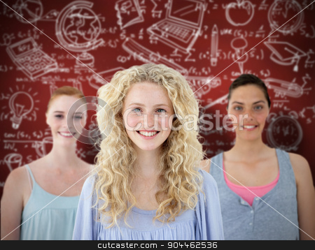 Composite image of beautiful tennage girls smiling stock photo, Beautiful tennage girls smiling against desk by Wavebreak Media