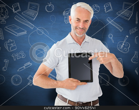 Composite image of mature student showing tablet pc stock photo, Mature student showing tablet pc against blue chalkboard by Wavebreak Media