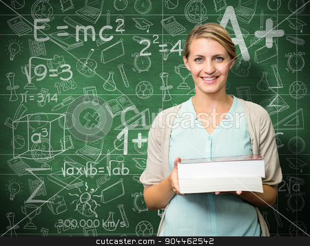 Composite image of smiling student stock photo, Smiling student against green chalkboard by Wavebreak Media