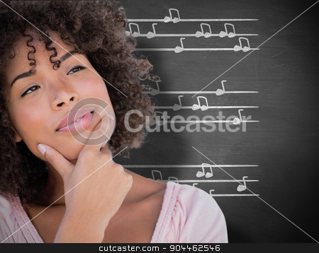 Composite image of pretty woman looking thoughtful stock photo, Pretty woman looking thoughtful against black background by Wavebreak Media