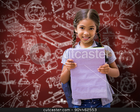 Composite image of cute pupil smiling at camera holding notepad  stock photo, Cute pupil smiling at camera holding notepad  against desk by Wavebreak Media