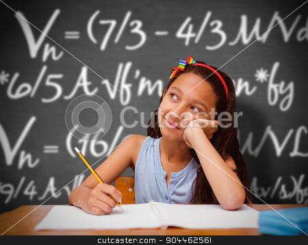Composite image of cute pupil at desk stock photo, Cute pupil at desk against black background by Wavebreak Media