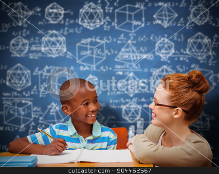 Composite image of happy pupil and teacher stock photo, Happy pupil and teacher against blue chalkboard by Wavebreak Media