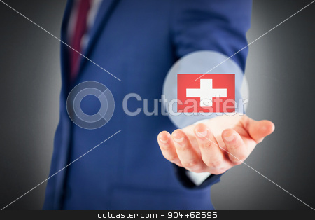 Composite image of close up view of businessman hand stock photo, Close up view of businessman hand against grey background by Wavebreak Media