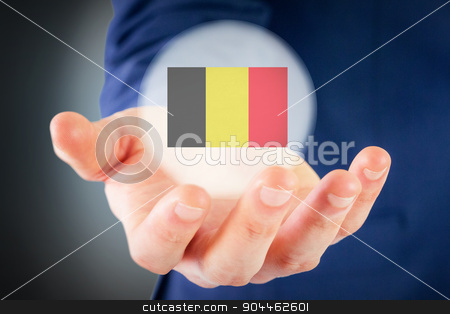Composite image of close up view of businessman hand stock photo, Close up view of businessman hand against blue background with vignette by Wavebreak Media