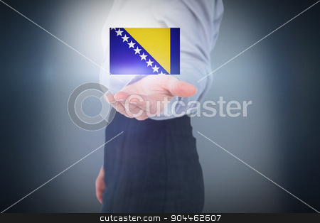 Composite image of businesswoman presenting with hand stock photo, Businesswoman presenting with hand against blue background by Wavebreak Media
