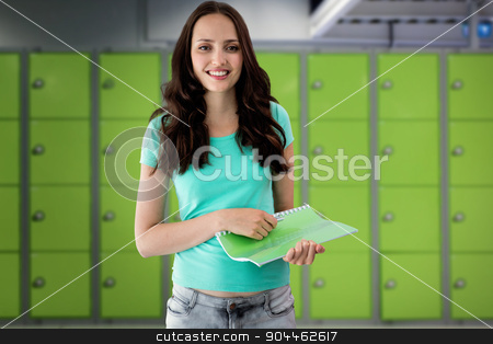 Composite image of portrait of smiling young woman with file stock photo, Portrait of smiling young woman with file against locker room by Wavebreak Media