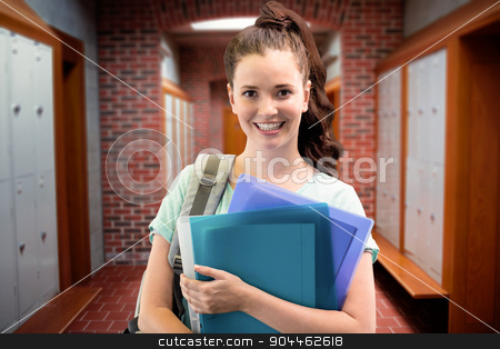 Composite image of smiling student stock photo, Smiling student against brick walled corridor with tiled flooring in college by Wavebreak Media