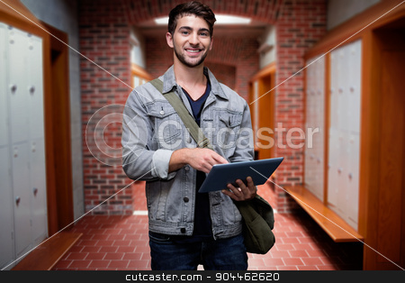 Composite image of student using tablet in library  stock photo, Student using tablet in library  against brick walled corridor with tiled flooring in college by Wavebreak Media