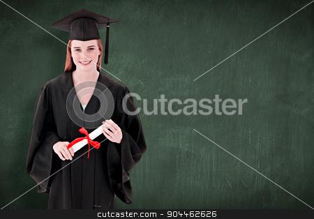 Composite image of teenage girl celebrating graduation stock photo, Teenage Girl Celebrating Graduation against green chalkboard by Wavebreak Media