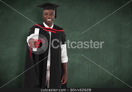 Composite image of man smilling at graduation stock photo, Man smilling at graduation against green chalkboard by Wavebreak Media