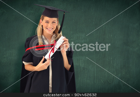 Composite image of woman smiling at her graduation  stock photo, Woman smiling at her graduation  against green chalkboard by Wavebreak Media